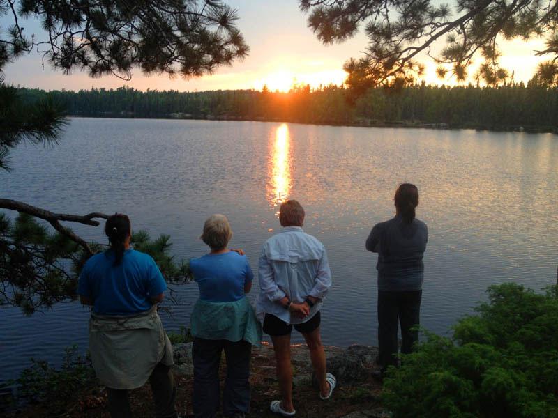 Friends view a sunset